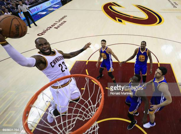 LeBron James of the Cleveland Cavaliers goes up for a dunk against the Golden State Warriors in the first half in Game 3 of the 2017 NBA Finals at...