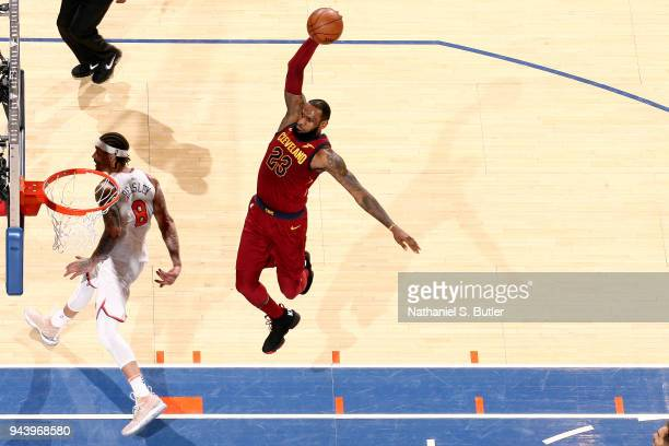 LeBron James of the Cleveland Cavaliers goes up for a dunk against the New York Knicks on April 9 2018 at Madison Square Garden in New York City New...