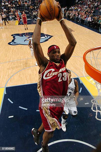 LeBron James of the Cleveland Cavaliers goes up for a dunk during a game against Lorenzen Wright of the Memphis Grizzlies on December 13 2004 at...