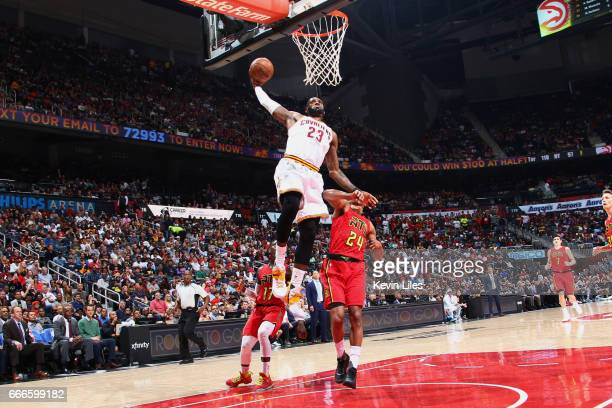 LeBron James of the Cleveland Cavaliers goes up for a dunk during a game against the Atlanta Hawks on April 9 2017 at Philips Arena in Atlanta...
