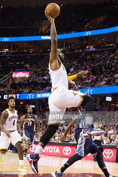 LeBron James of the Cleveland Cavaliers goes up for a dunk during the second half against the Memphis Grizzlies at Quicken Loans Arena on March 7...