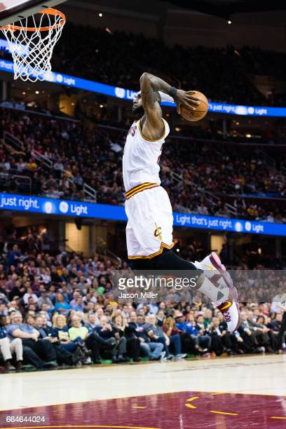 LeBron James of the Cleveland Cavaliers goes up for a dunk during the second half against the Orlando Magic at Quicken Loans Arena on April 4 2017 in...