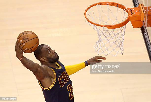 LeBron James of the Cleveland Cavaliers goes up for a dunk in the second quarter against the Toronto Raptors in game four of the Eastern Conference...