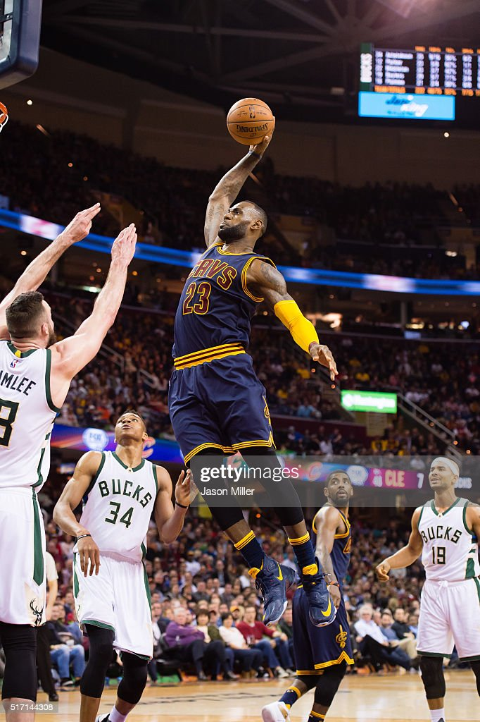 LeBron James #23 of the Cleveland Cavaliers goes up for a dunk over Miles Plumlee #18 of the Milwaukee Bucks during the second half at Quicken Loans Arena on March 23, 2016 in Cleveland, Ohio. The Cavaliers defeated the Bucks 113-104.