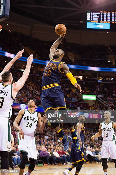 LeBron James of the Cleveland Cavaliers goes up for a dunk over Miles Plumlee of the Milwaukee Bucks during the second half at Quicken Loans Arena on...