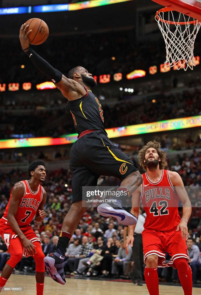 LeBron James #23 of the Cleveland Cavaliers goes up for a dunk over Robin Lopez #42 of the Chicago Bulls at the United Center on December 4, 2017 in Chicago, Illinois.