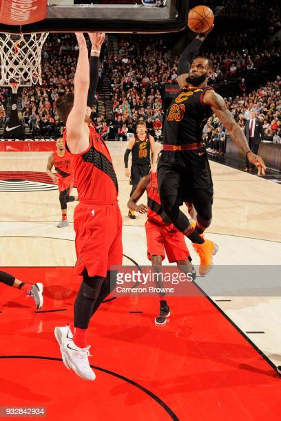 LeBron James of the Cleveland Cavaliers goes up for a dunk while guarded by Jusuf Nurkic of the Portland Trail Blazers on March 15 2018 at the Moda...