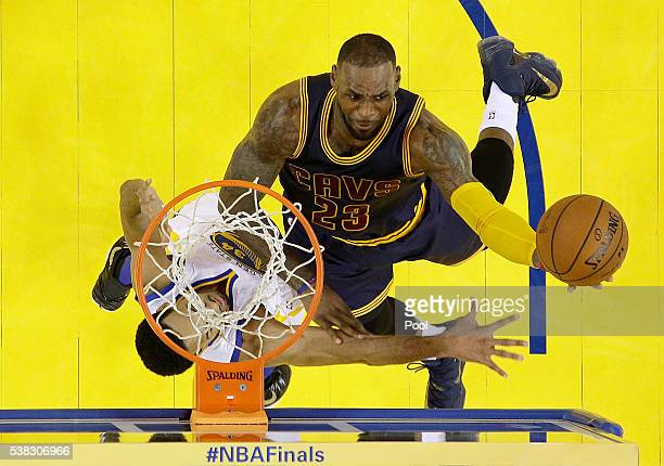 LeBron James of the Cleveland Cavaliers goes up for a shot against Shaun Livingston of the Golden State Warriors in Game 2 of the 2016 NBA Finals at...