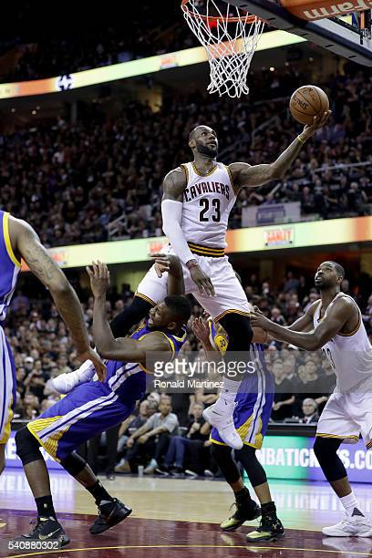 LeBron James of the Cleveland Cavaliers goes up for a shot against Festus Ezeli of the Golden State Warriors in Game 6 of the 2016 NBA Finals at...