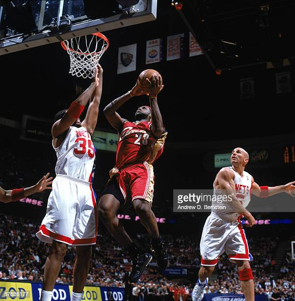 LeBron James of the Cleveland Cavaliers goes up for a shot against Jason Collins of the New Jersey Nets during a game at Continental Airlines Arena...