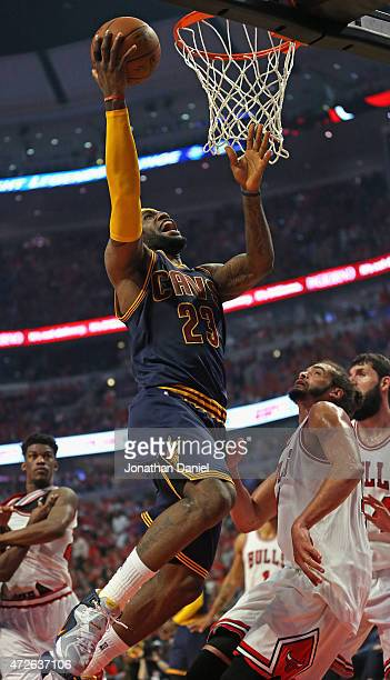 LeBron James of the Cleveland Cavaliers goes up for a shot over Joakim Noah of the Chicago Bulls in Game Three of the Eastern Conference Semifinals...