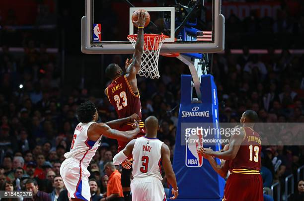 LeBron James of the Cleveland Cavaliers goes up for a slam dunk in the second half of the NBA game against the Los Angeles Clippers at Staples Center...