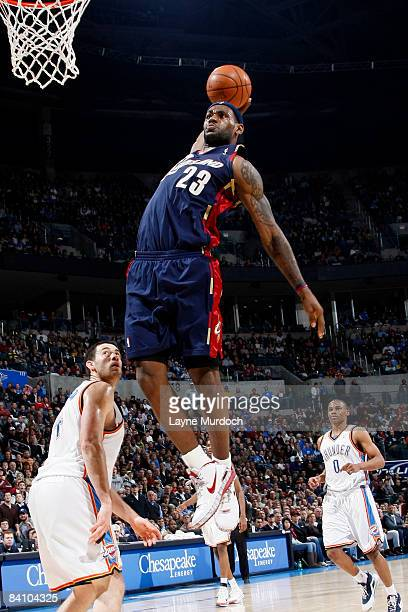 LeBron James of the Cleveland Cavaliers goes up for a slam dunk against Nick Collison of the Oklahoma City Thunder on December 21 2008 at the Ford...