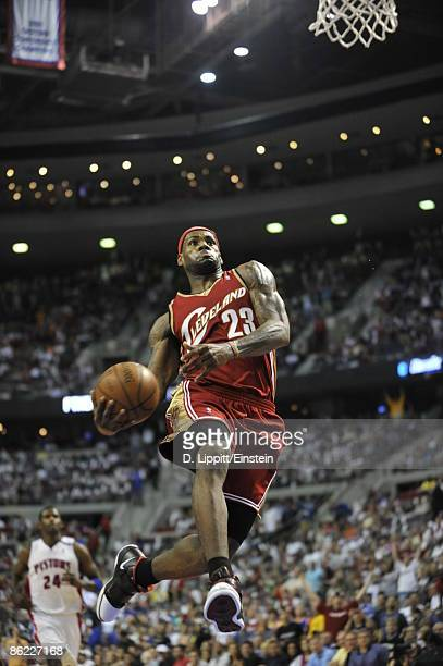 LeBron James of the Cleveland Cavaliers goes up for a windmill dunk past Antonio McDyess of the Detroit Pistons in Game Four of the Eastern...