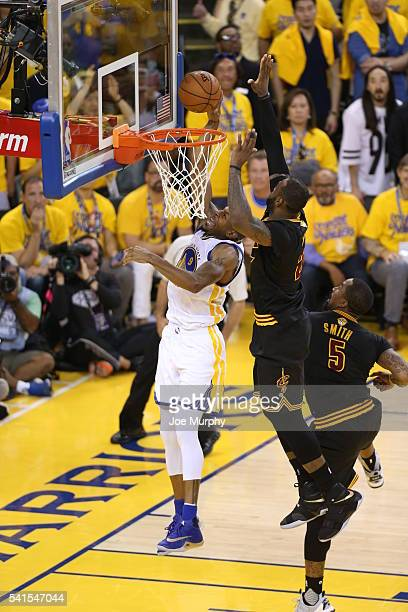 LeBron James of the Cleveland Cavaliers goes up to block a shot against Andre Iguodala of the Golden State Warriors during Game Seven of the 2016 NBA...