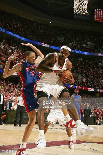 LeBron James of the Cleveland Cavaliers grabs a rebound against Tayshaun Prince of the Detroit Pistons in Game Six of the Eastern Conference Finals...