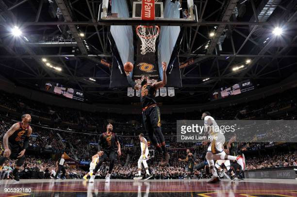LeBron James of the Cleveland Cavaliers grabs the rebound against the Golden State Warriors on January 15 2018 at Quicken Loans Arena in Cleveland...