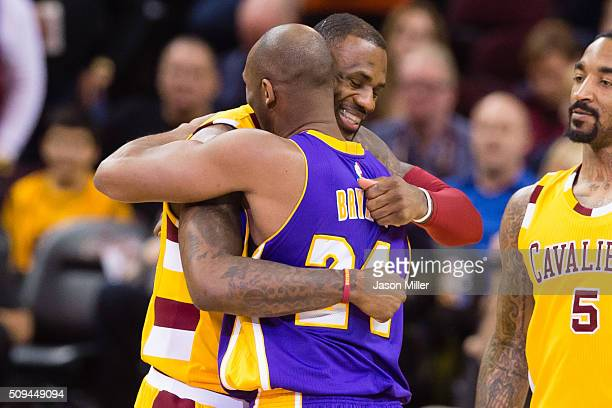 LeBron James of the Cleveland Cavaliers greets Kobe Bryant of the Los Angeles Lakers during the first half at Quicken Loans Arena on February 10 2016...
