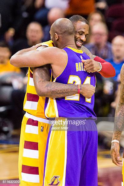 LeBron James of the Cleveland Cavaliers greets Kobe Bryant of the Los Angeles Lakers prior to the game at Quicken Loans Arena on February 10 2016 in...