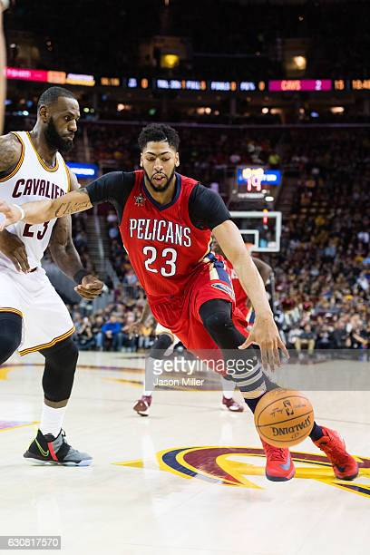 LeBron James of the Cleveland Cavaliers guards Anthony Davis of the New Orleans Pelicans during the first half at Quicken Loans Arena on January 2...