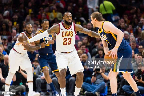 LeBron James of the Cleveland Cavaliers guards Joe Ingles of the Utah Jazz during the first half at Quicken Loans Arena on December 16, 2017 in...