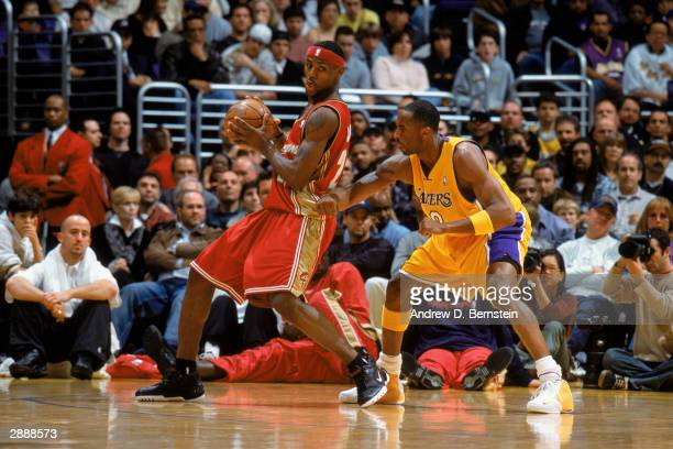 LeBron James of the Cleveland Cavaliers guards the ball against Kobe Bryant of the Los Angeles Lakers during the NBA game at Staples Center on...
