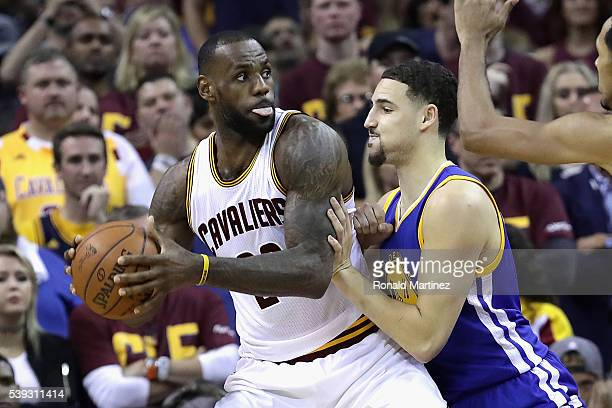 LeBron James of the Cleveland Cavaliers handles the ball against Klay Thompson of the Golden State Warriors during the first half in Game 4 of the...