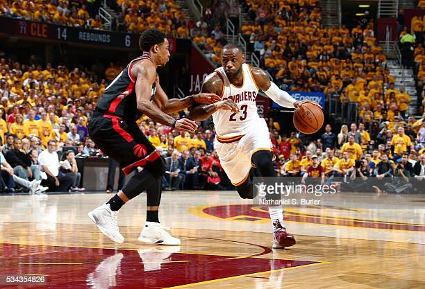 LeBron James of the Cleveland Cavaliers handles the ball against DeMar DeRozan of the Toronto Raptors in Game Five of the Eastern Conference Finals...