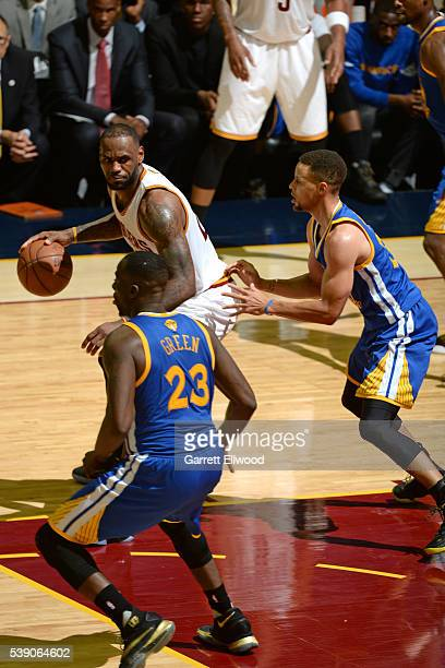 LeBron James of the Cleveland Cavaliers handles the ball against Stephen Curry of the Golden State Warriors during the 2016 NBA Finals Game Three on...