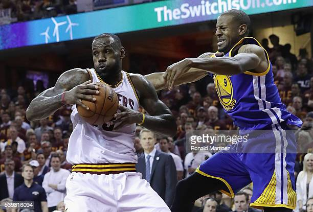 LeBron James of the Cleveland Cavaliers handles the ball against Andre Iguodala of the Golden State Warriors during the first half in Game 4 of the...