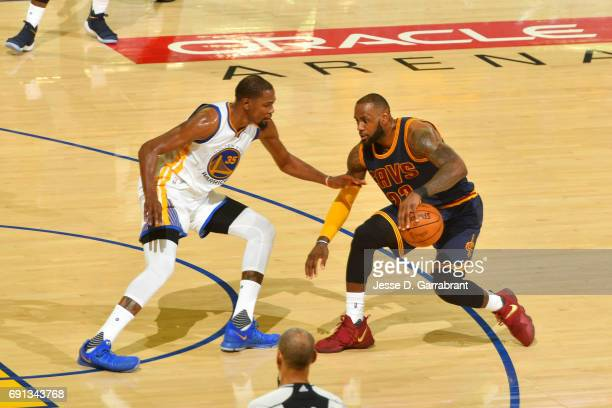 LeBron James of the Cleveland Cavaliers handles the ball against Kevin Durant of the Golden State Warriors in Game One of the 2017 NBA Finals on June...