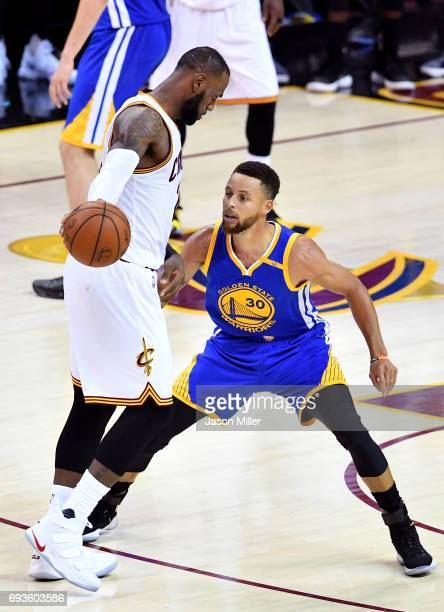 LeBron James of the Cleveland Cavaliers handles the ball against Stephen Curry of the Golden State Warriors in the second half in Game 3 of the 2017...