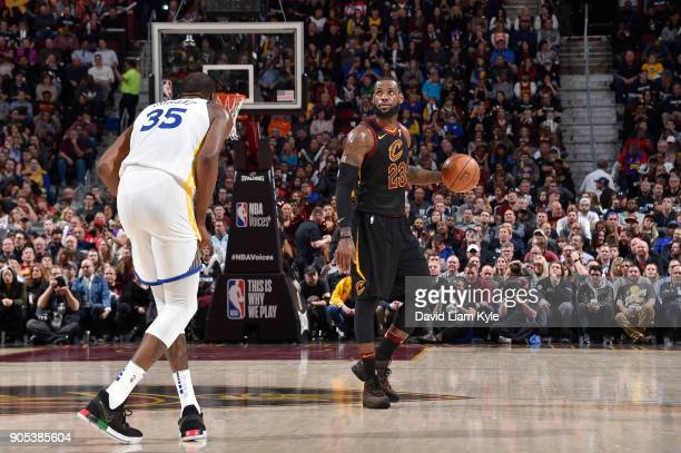 LeBron James of the Cleveland Cavaliers handles the ball against Kevin Durant of the Golden State Warriors on January 15 2018 at Quicken Loans Arena...