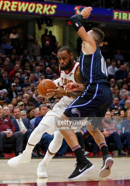 LeBron James of the Cleveland Cavaliers handles the ball against Aaron Gordon of the Orlando Magic at Quicken Loans Arena on January 18 2018 in...