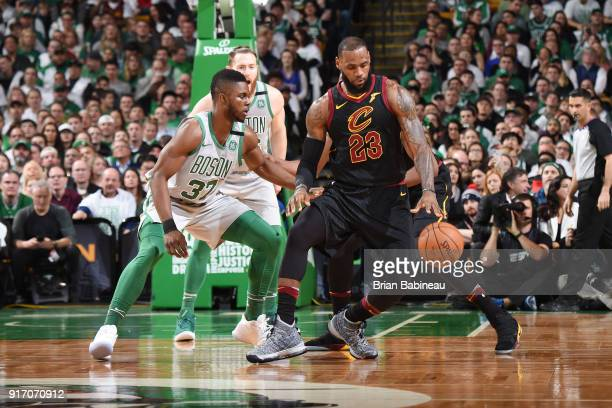 LeBron James of the Cleveland Cavaliers handles the ball against Daniel Theis of the Boston Celtics during the game between the two teams on February...