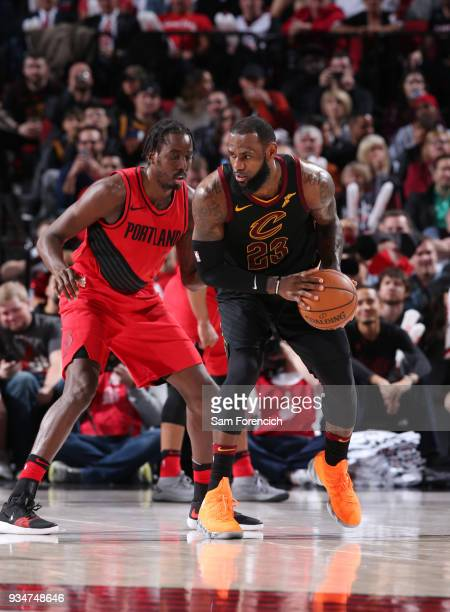 LeBron James of the Cleveland Cavaliers handles the ball against AlFarouq Aminu of the Portland Trail Blazers on March 15 2018 at the Moda Center...