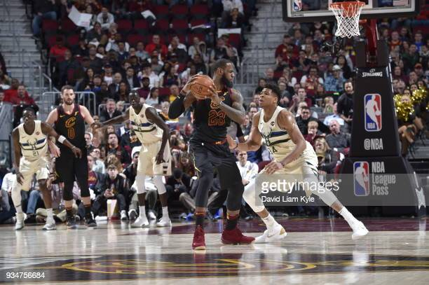LeBron James of the Cleveland Cavaliers handles the ball against Giannis Antetokounmpo of the Milwaukee Bucks on March 19 2018 at Quicken Loans Arena...