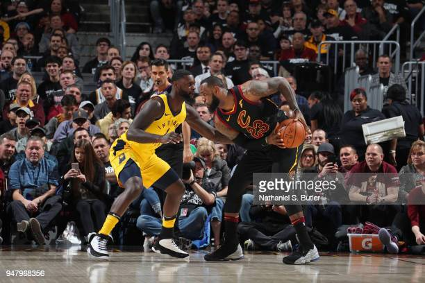 LeBron James of the Cleveland Cavaliers handles the ball against Lance Stephenson of the Indiana Pacers in Game One of Round One of the 2018 NBA...