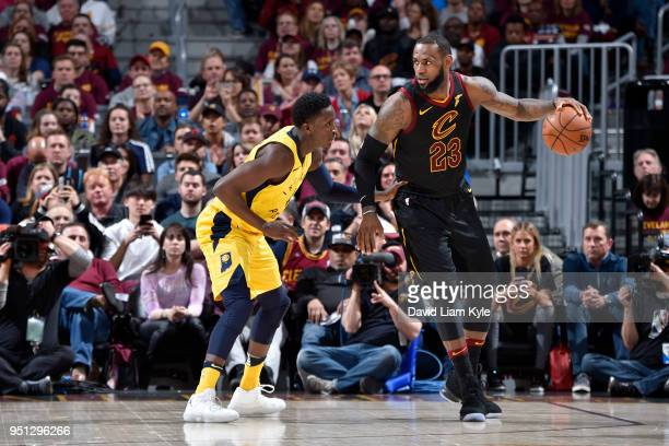 LeBron James of the Cleveland Cavaliers handles the ball against Victor Oladipo of the Indiana Pacers in Game Five of Round One of the 2018 NBA...