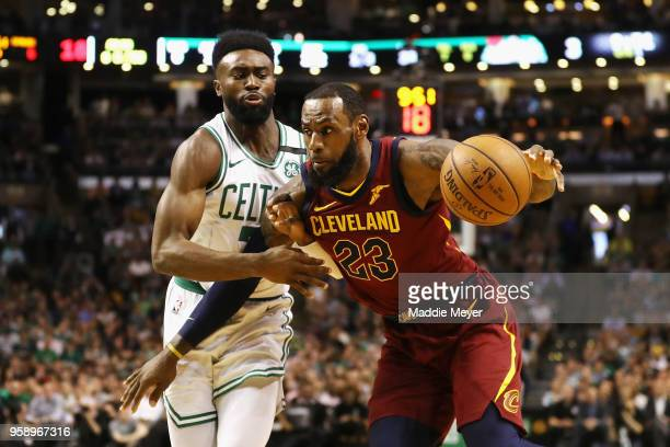LeBron James of the Cleveland Cavaliers handles the ball against Jaylen Brown of the Boston Celtics in the first half during Game Two of the 2018 NBA...
