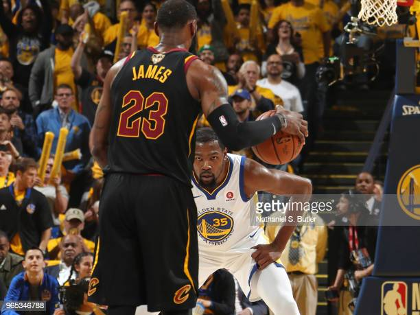 LeBron James of the Cleveland Cavaliers handles the ball against Kevin Durant of the Golden State Warriors in Game One of the 2018 NBA Finals on May...