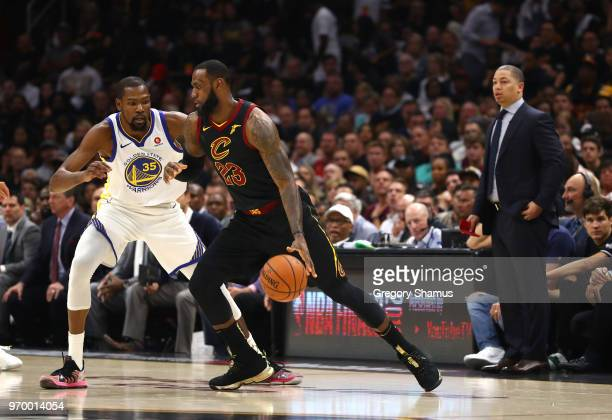 LeBron James of the Cleveland Cavaliers handles the ball against Kevin Durant of the Golden State Warriors in the first quarter during Game Four of...