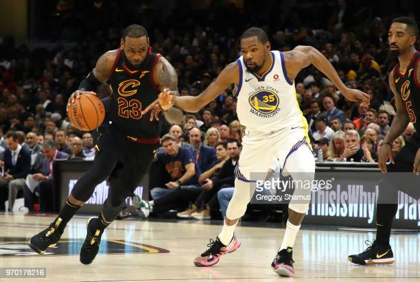 LeBron James of the Cleveland Cavaliers handles the ball against Kevin Durant of the Golden State Warriors in the second half during Game Four of the...