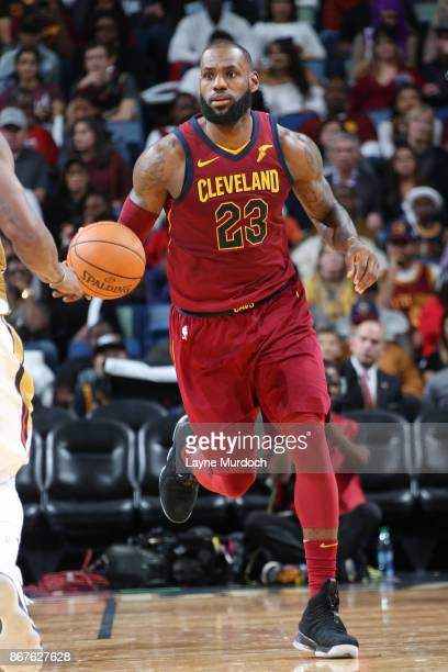 LeBron James of the Cleveland Cavaliers handles the ball against the New Orleans Pelicans on October 28 2017 at the Smoothie King Center in New...