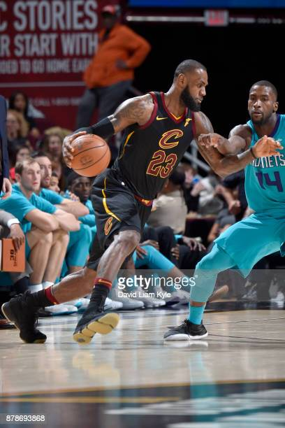 LeBron James of the Cleveland Cavaliers handles the ball against the Charlotte Hornets on Novmber 24 2017 at Quicken Loans Arena in Cleveland Ohio...