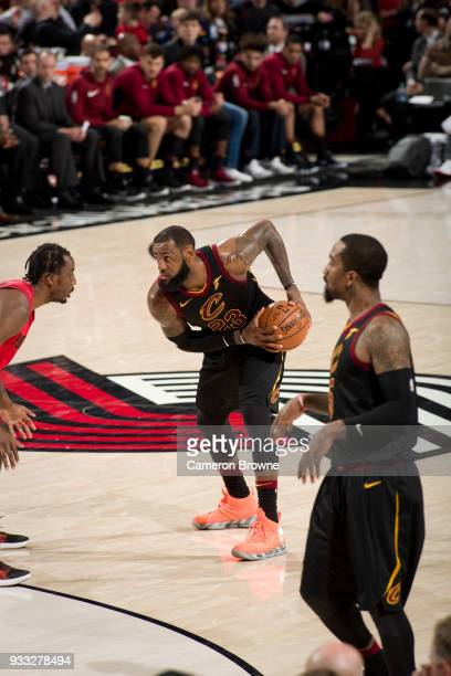 LeBron James of the Cleveland Cavaliers handles the ball against the Portland Trail Blazers on March 15 2018 at the Moda Center in Portland Oregon...