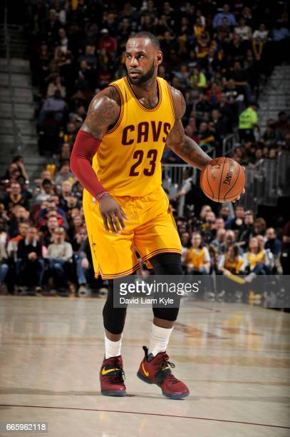 LeBron James of the Cleveland Cavaliers handles the ball during a game against the Atlanta Hawks on April 7 2017 at Quicken Loans Arena in Cleveland...