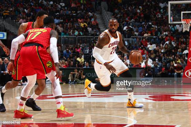 LeBron James of the Cleveland Cavaliers handles the ball during a game against the Atlanta Hawks on April 9 2017 at Philips Arena in Atlanta Georgia...