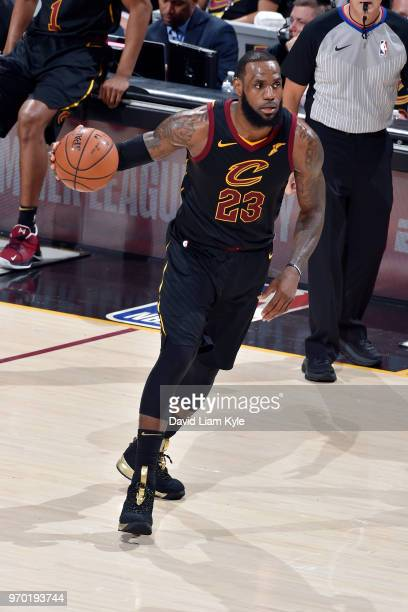 OH LeBron James of the Cleveland Cavaliers handles the ball during the game against the Golden State Warriors in Game Four of the 2018 NBA Finals on...