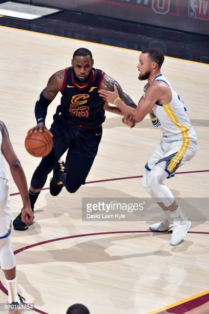 OH LeBron James of the Cleveland Cavaliers handles the ball during the game against Stephen Curry of the Golden State Warriors in Game Four of the...